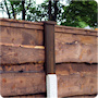 5ft waney lap panels in 3ft posts with 2ft fence post extensions.
