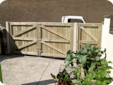 Double wooden tonge and groove gates with single tongue and groove gate.